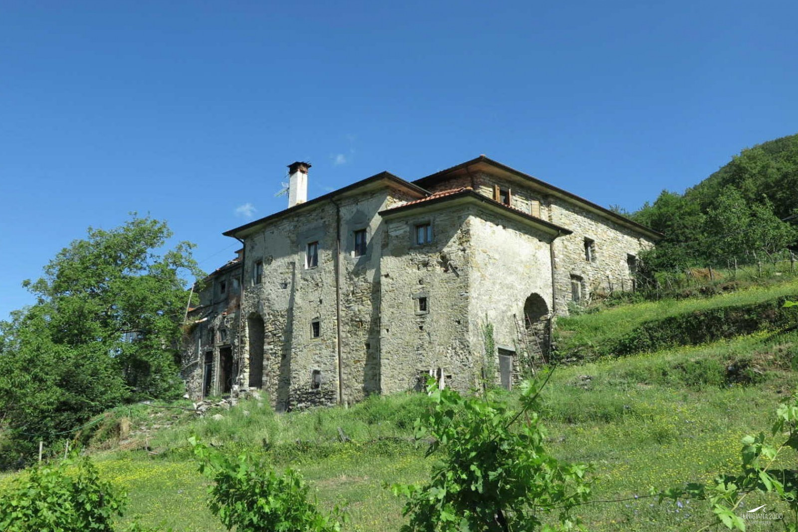 Typical restored stone farmhouse with land in a panoramic position
